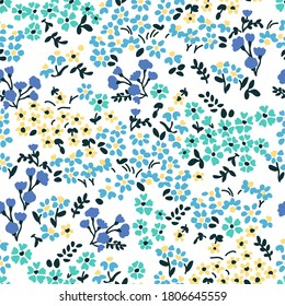 Small summer flowers on white background. Seamless vector pattern. Vintage print with   inflorescences. Retro textile collection.