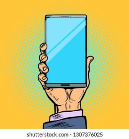 smartphone in male hand. Pop art retro vector illustration kitsch vintage