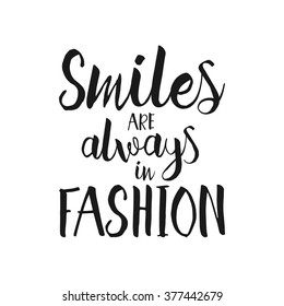 Smiles are always in fashion - Hand drawn inspirational quote. Vector isolated typography design element. Brush lettering good for posters, t-shirts, prints, banners. Housewarming hand lettering quote