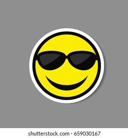 Smiley emoticon in sunglasses vector paper sticker.