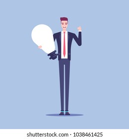 Smiling businessman holds a big light bulb as a symbol of a new idea flat vector. A happy man in a suit stands with a  idea in his hands and shows thumb up. Business concept idea and inspiration.