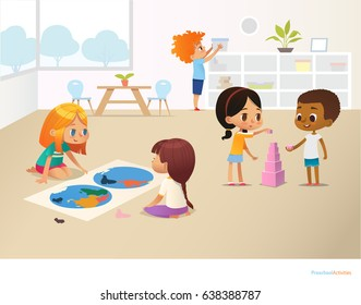 Smiling kids doing different tasks at primary school. Boys and girls building pyramid out of pink blocks and viewing world map. Montessori environment concept. Vector illustration for poster, banner.