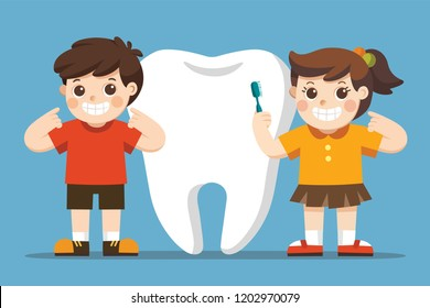 Smiling Kids standing next to big white tooth. A girl holding toothbrush showing healthy clean tooth. Hygiene and care.