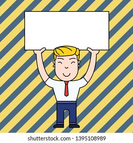 Smiling Young Male in Formal Clothes Standing and Holding Big Empty Placard Overhead with Both Hands. Creative Background Space for Announcements and Promotions