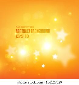 Smooth luminous stars. Orange glow blur background
