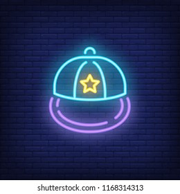 Snapback neon sign. Luminous signboard with headwear. Night bright advertisement. Vector illustration in neon style for fashion, subculture, rap