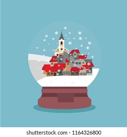 Snow globe with small town and church