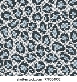 Snow leopard jacquard seamless pattern. Knitted texture. Winter background. Vector illustration.