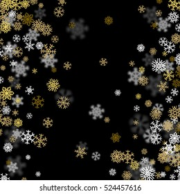 Snowfall background with golden snowflakes blurred in perspective.