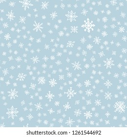 Snowflake doodle seamless pattern. Snow on blue background. Merry Christmas holiday, Happy New Year celebration Vector illustration