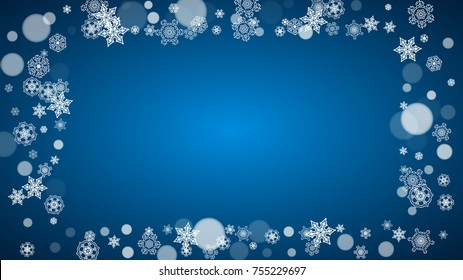 Snowflakes falling on blue background. Christmas and New Year horizontal theme. Frosty falling snowflakes for banners, gift card, party invitation, compliments and special business offer