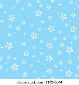Snowflakes on blue sky - Christmas seamless background