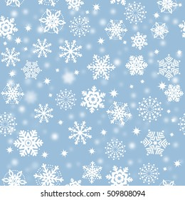 Snowflakes on blue sky, snowstorm - Christmas seamless background