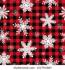 Snowflakes on a Buffalo plaid background. Vector Seamless Winter Pattern. Festive retro texture.