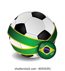 Soccer ball wrapped in medal strap and badge with Brazil flag