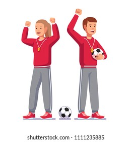 Soccer coach man & woman raising hands in clenched fists gesture, cheering players, shouting, smiling, training football team standing holding soccer ball. Football game coach flat vector illustration