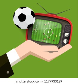 Soccer Match on Retro TV. Football Game Design with Ball and Human Hand on Green Background.