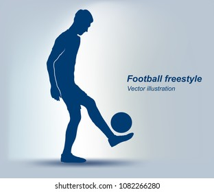 Soccer player juggling a football isolated