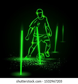 Soccer training process. Green neon soccer player training with ball between the sticks.