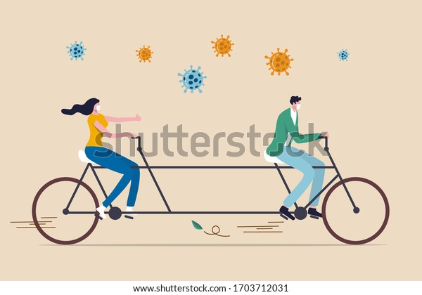 Distance sociale, les gens gardent la distance en public pour se protéger du concept de propagation de l'épidémie de Coronavirus COVID-19, couple homme et femme gardent la distance sur bicyclette tandem avec les agents pathogènes Coronavirus.