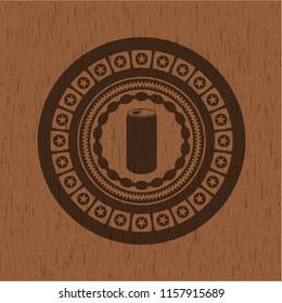 soda can icon inside wood badge or emblem