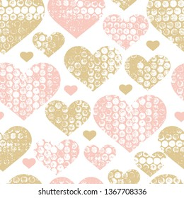 Soft bubble wrap textured seamless hearts vector pattern. Pink and gold background.