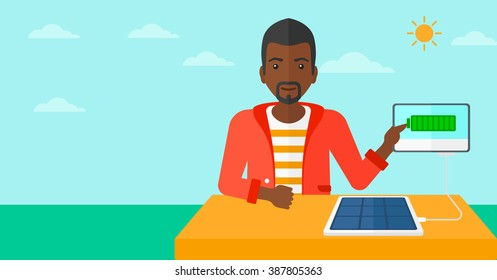 Solar panel charging tablet computer.