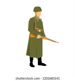 a soldier during the second world war, standing with a carbine in his hands. Dressed in a green overcoat