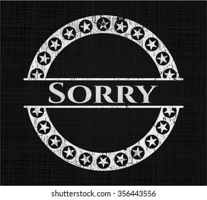 Sorry chalk emblem written on a blackboard
