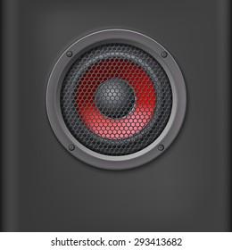 Sound speaker with grille on dark background.