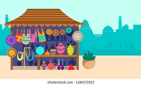 Souvenir street store with city on the background. Pottery, bags and jewelry