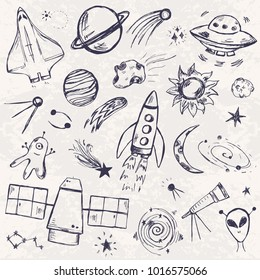 Space themed hand drawn set. Planets, stars, UFO and other cosmic elements in doodle style.