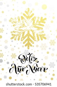Spanish Happy New Year text Feliz Ano Nuevo of golden snowflake pattern. Hand drawn calligraphy lettering, glittering holiday greeting card. Gold glitter Christmas snow balls white premium background