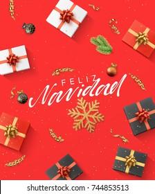 Spanish text Feliz Navidad. Christmas composition. gift, confetti, golden snowflake and balls, Xmas tree branch.
