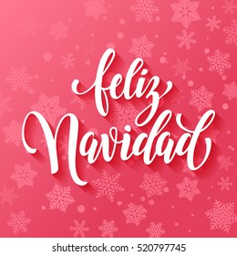 Spanish text for Merry Christmas greeting. Feliz Navidad card with calligraphic lettering design on pink snow background with snowflakes pattern