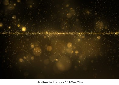 Sparkling golden dust on black. Shiny glittering effect. Abstract glowing light luxury background
