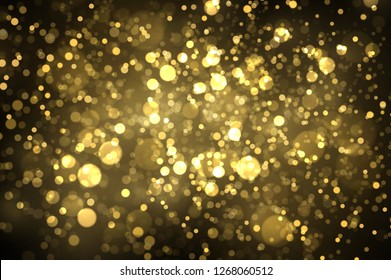 Sparkling golden particles explosion. Glowing bokeh lights abstract background