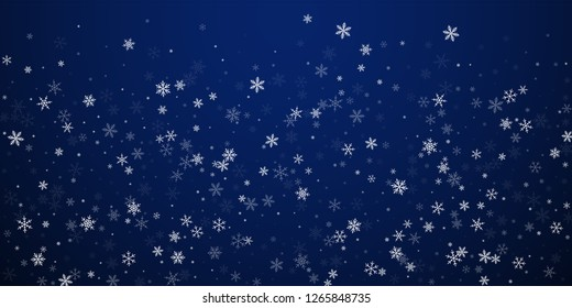 Sparse snowfall Christmas background. Subtle flying snow flakes and stars on dark blue night background. Beautiful winter silver snowflake overlay template. Delicate vector illustration.