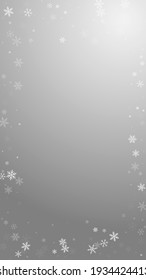 Sparse snowfall Christmas background. Subtle flying snow flakes and stars on grey background. Amusing winter silver snowflake overlay template. Astonishing vertical illustration.