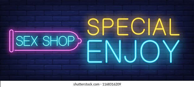 Special Enjoy neon sign. Glowing Sex shop lettering in condom outline on brick background. Night bright advertisement. Vector illustration in neon style for erotic and shopping