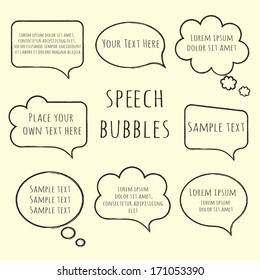 Speech bubble collection. Set of  hand-drawn speech and thought bubbles with sample text isolated on beige background. Vector illustration.