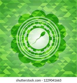 sperm icon inside green emblem. Mosaic background
