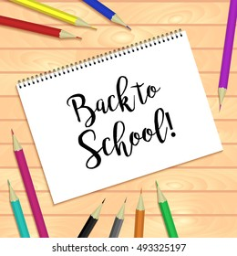 Spiral bound notepads and pen. Vector horizontal template or mock up. Back to school inscription. Easy to place your image on the cover.Top view.