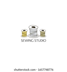 Spools of thread. Logo, template for sewing workshop, Atelier, handmade workshop, fashion designer, industry, store. Vector illustration hand drawing