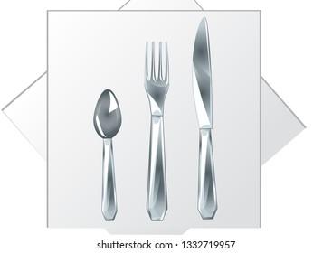 spoon, fork, knife on a white napkin