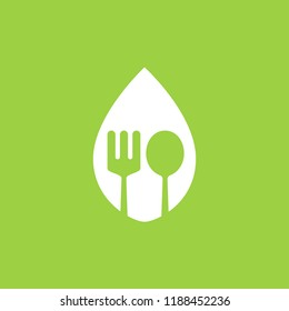 Spoon and fork logo in a leaf vector