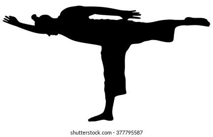 Sporty man doing exercise for legs, balancing in Warrior III posture, Virabhadrasana 3- Yoga position