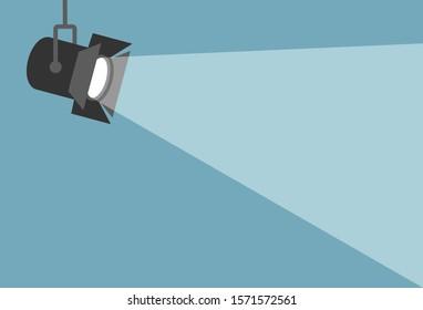 Spotlight shining flat illustration. Movie spotlight on blue background