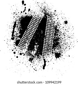 Spray paint blots with white tire tracks