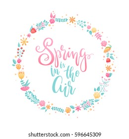 Spring is in the air - hand lettering design element in a colorful floral wreath. Perfect for housewarming posters, prints, greeting cards and advertisement.